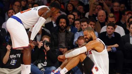 Tyson Chandler sits on the floor after an