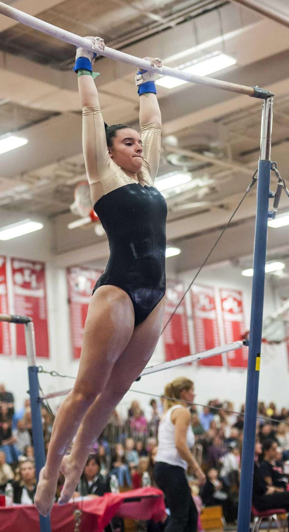 Ward Melville's Cydney Crasa performs on the bars
