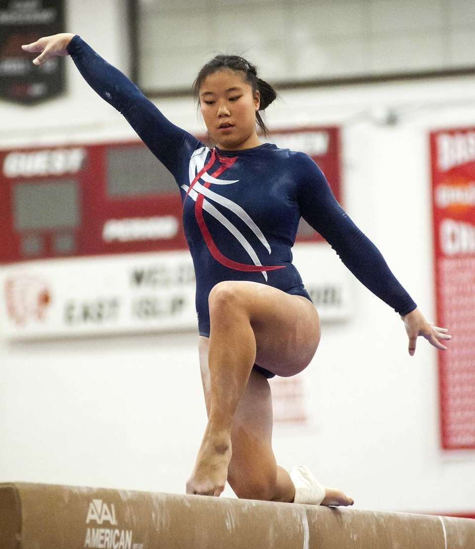Smithtown's Taylor VanNostrand performs on the beam during