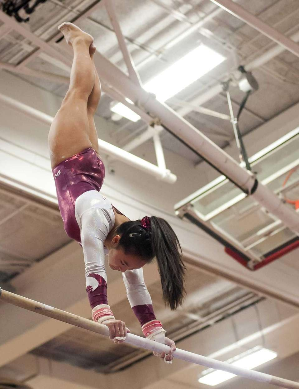 Bay Shore's Mattea Gravina performs on the bars