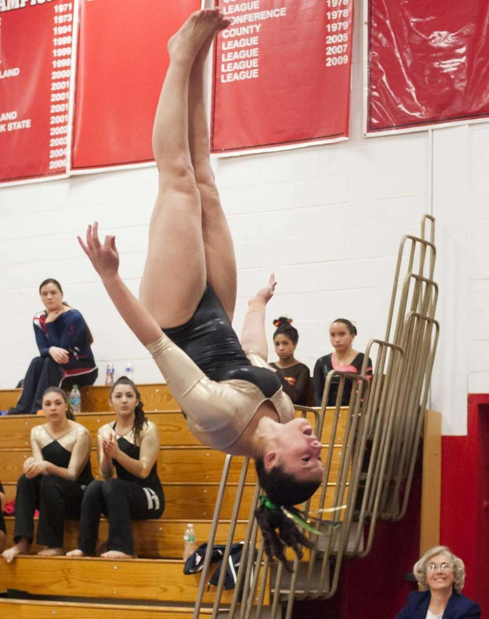 Ward Melville's Cydney Crasa performs on the vault