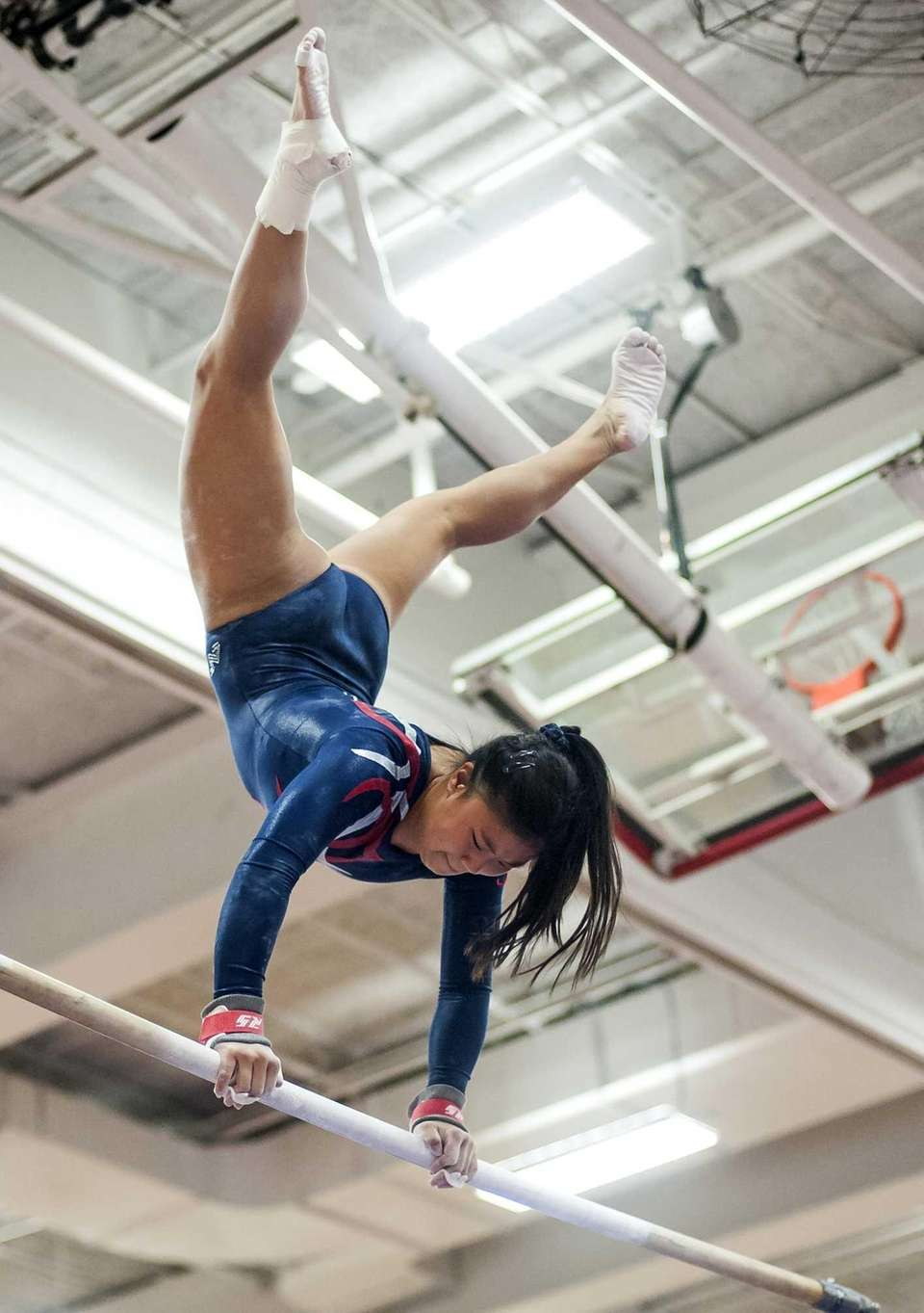 Smithtown's Taylor VanNostrand performs on the bars during