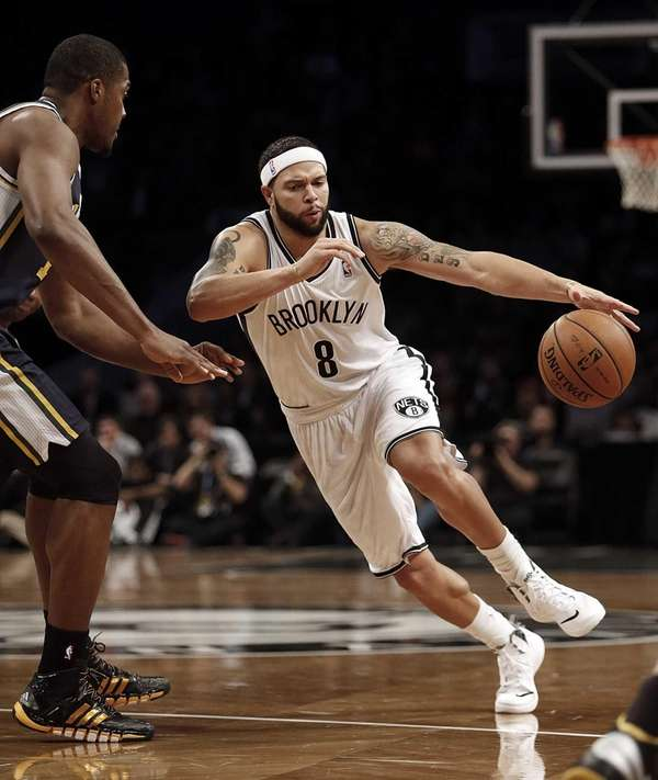 Nets point guard Deron Williams drives against Utah