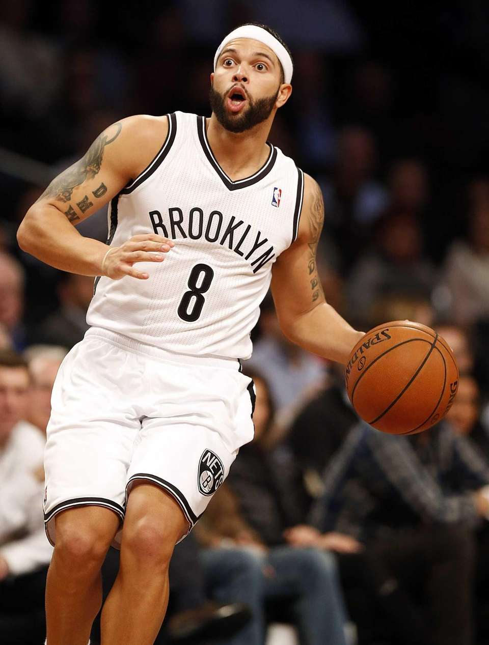Nets point guard Deron Williams brings the ball