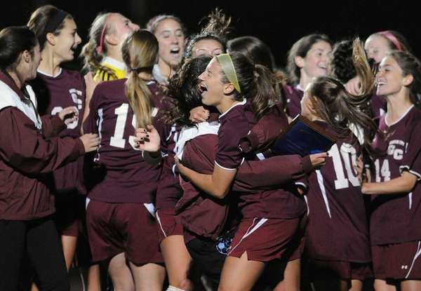 Garden City teammates celebrate after their penalty-kicks win