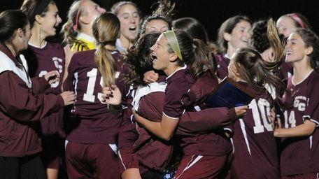 Garden City teammates celebrate after their penalty-kicks win