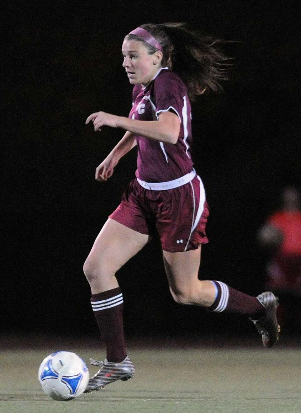 Garden City's Haley O'Hanlon heads downfield in the