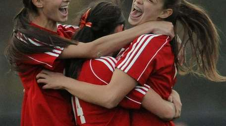 Wheatley's Adena Bernot, right, gets mobbed by teammates
