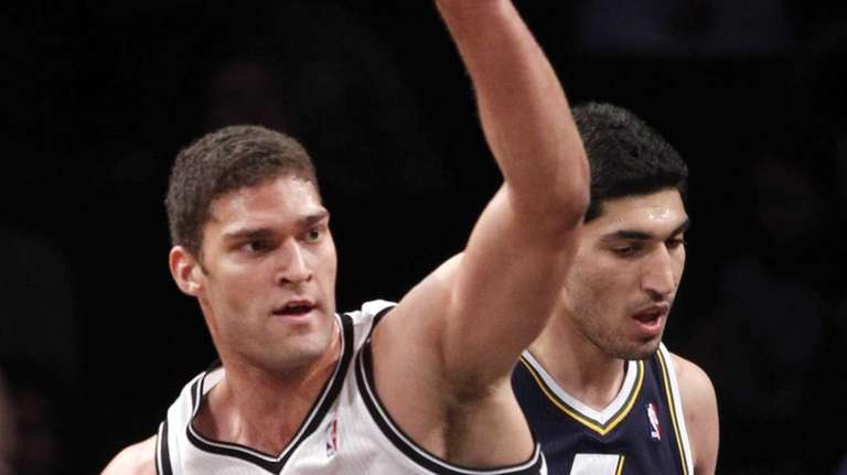 Brook Lopez reacts after scoring during a game