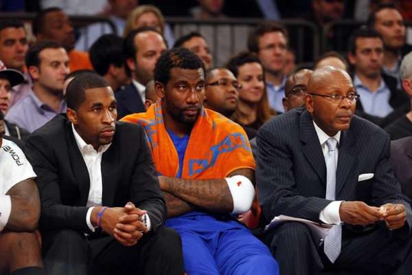 Amar'e Stoudemire sits on the bench late in