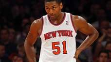 Metta World Peace looks on during the second