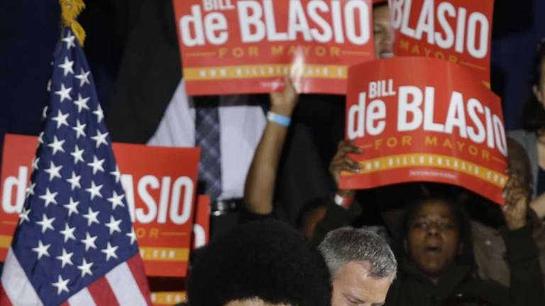 Democratic mayoral candidate Bill de Blasio embraces his