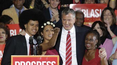 Democratic Mayor-elect Bill de Blasio poses with son