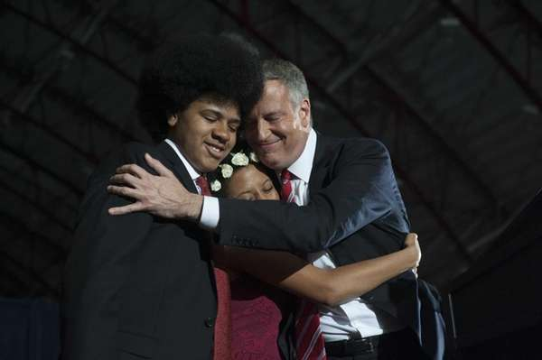 Mayor-elect Bill de Blasio hugs his daughter Chiara