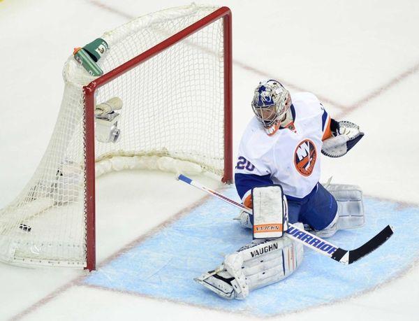 New York Islanders goalie Evgeni Nabokov gets beat