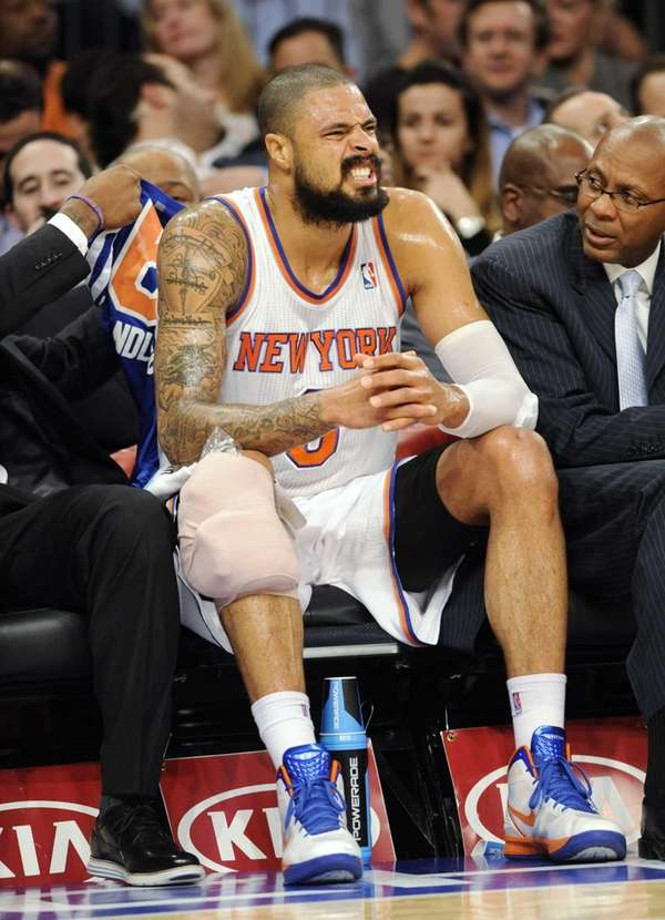 Tyson Chandler sits on the bench with his