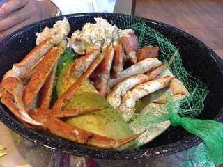 Crab legs with corn on the cob at