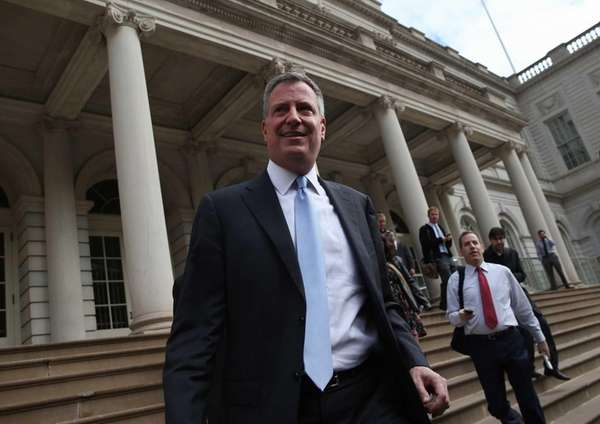 New York City Mayor-elect Bill de Blasio leaves