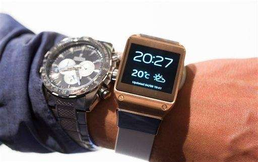 A man tries a Samsung Galaxy Gear, right,