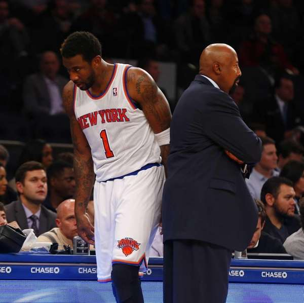 Amar'e Stoudemire walks past Mike Woodson as he