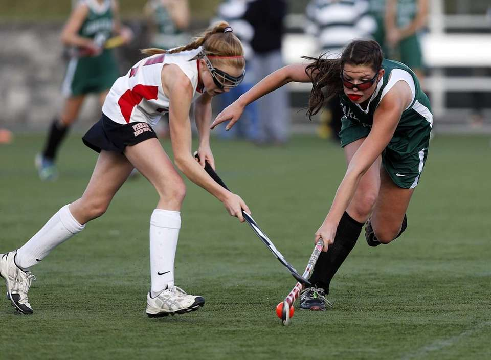 Carle Place's Shannon McGuinness tries to take the