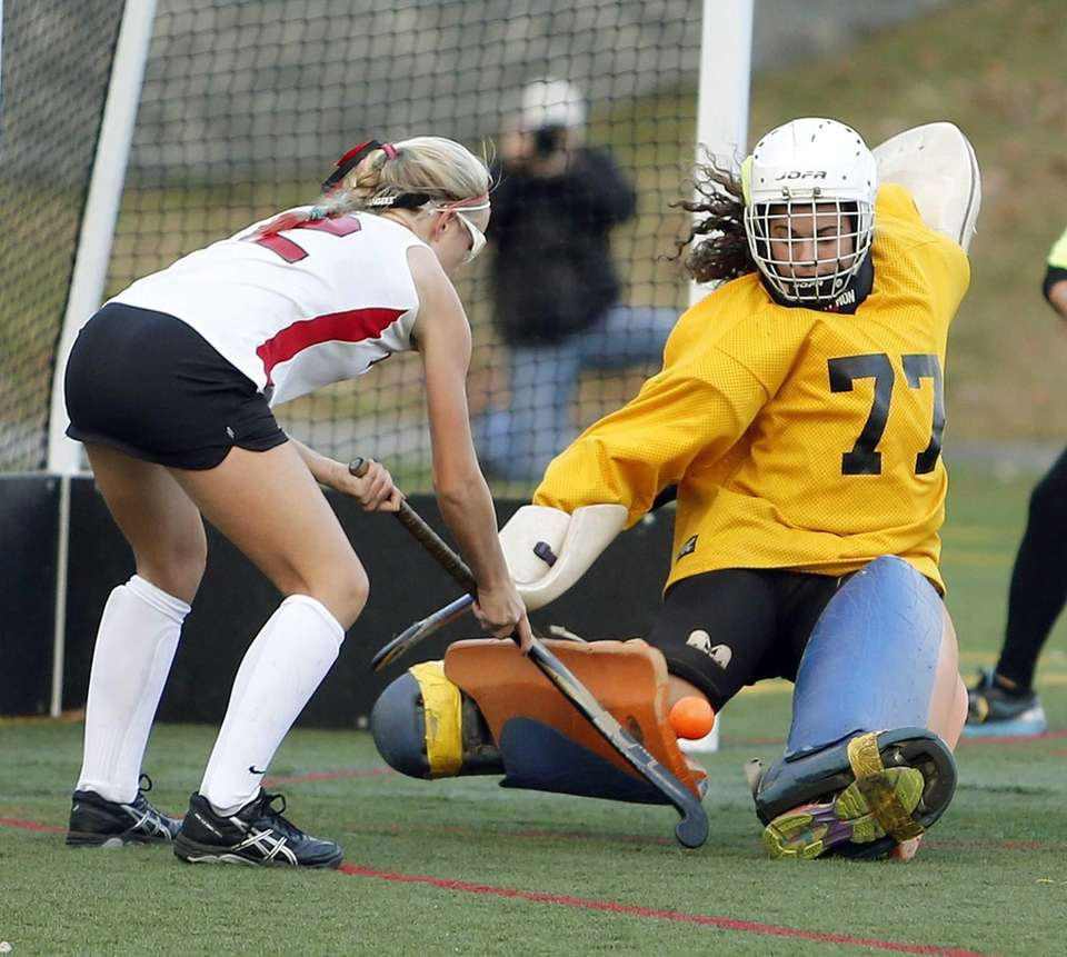 Carle Place goalie Lydia Rice makes a save