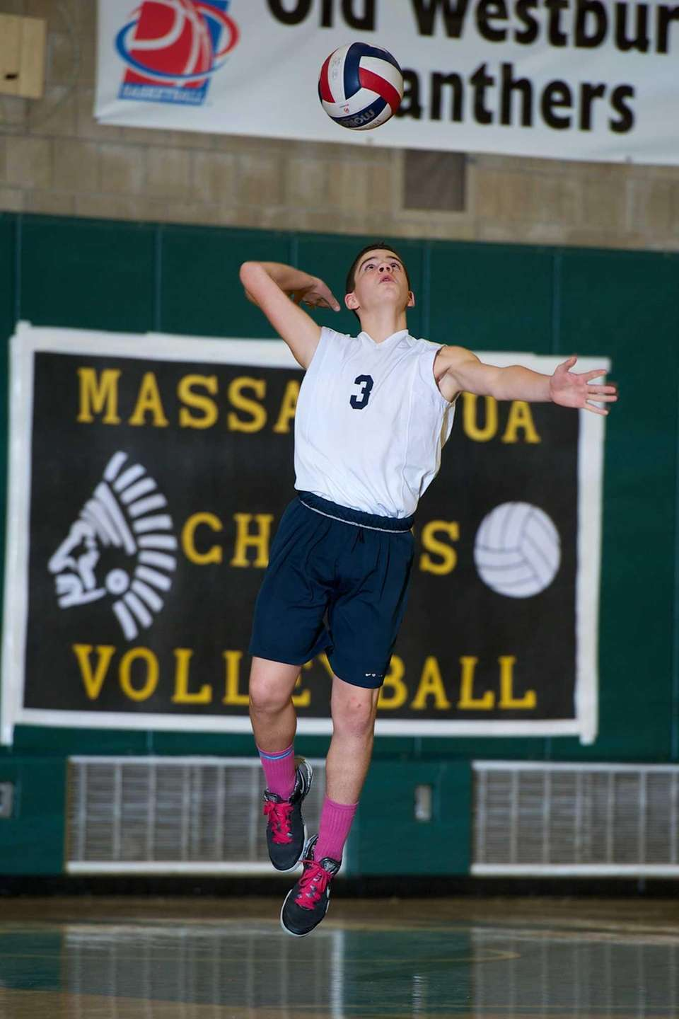 Massapequa sophomore John Delgiudice serves the ball in