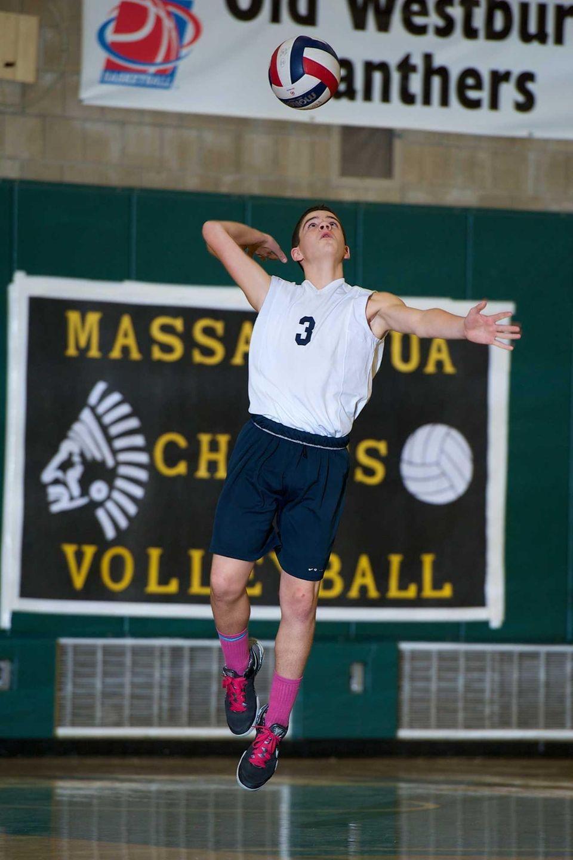 Massapequa sophomore John Delgiudice serves the ball in