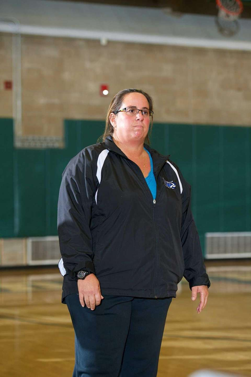 Port Washington head coach Maria Giamanco watches the