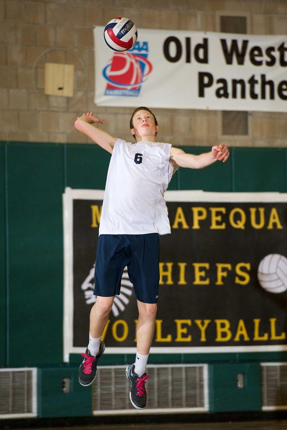 Massapequa junior Nicholas Smith serves the ball in