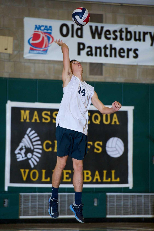 Massapequa senior Matthew Goldberg serves the ball in