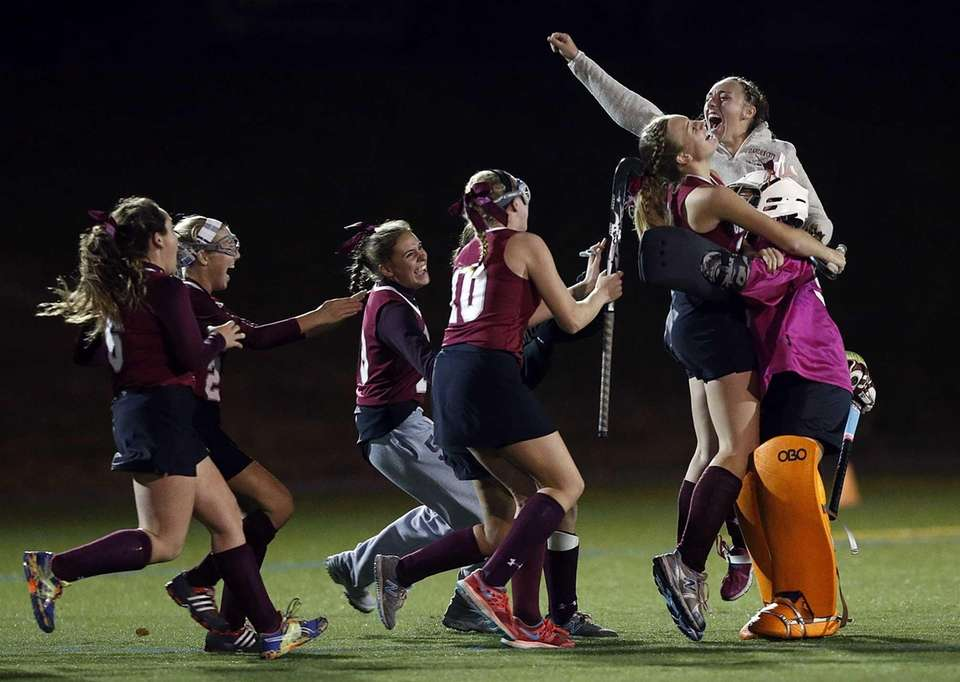 Garden City field hockey players celebrate their overtime