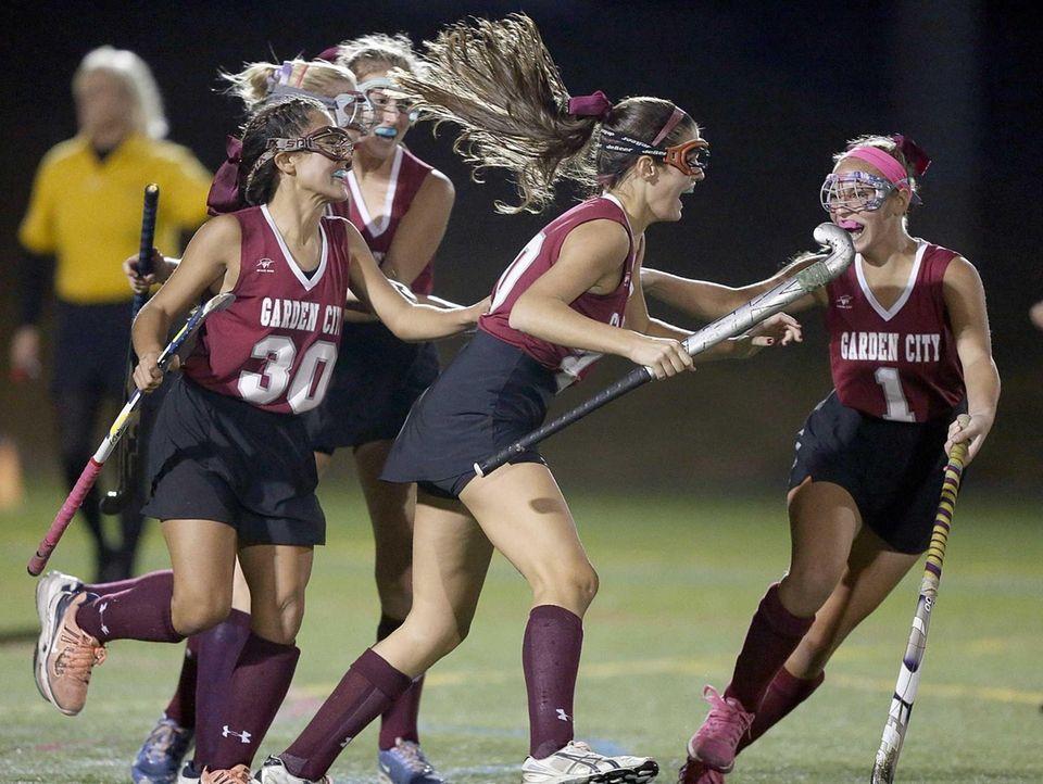 Garden City's Melanie McHugh, center, celebrates her game-winning