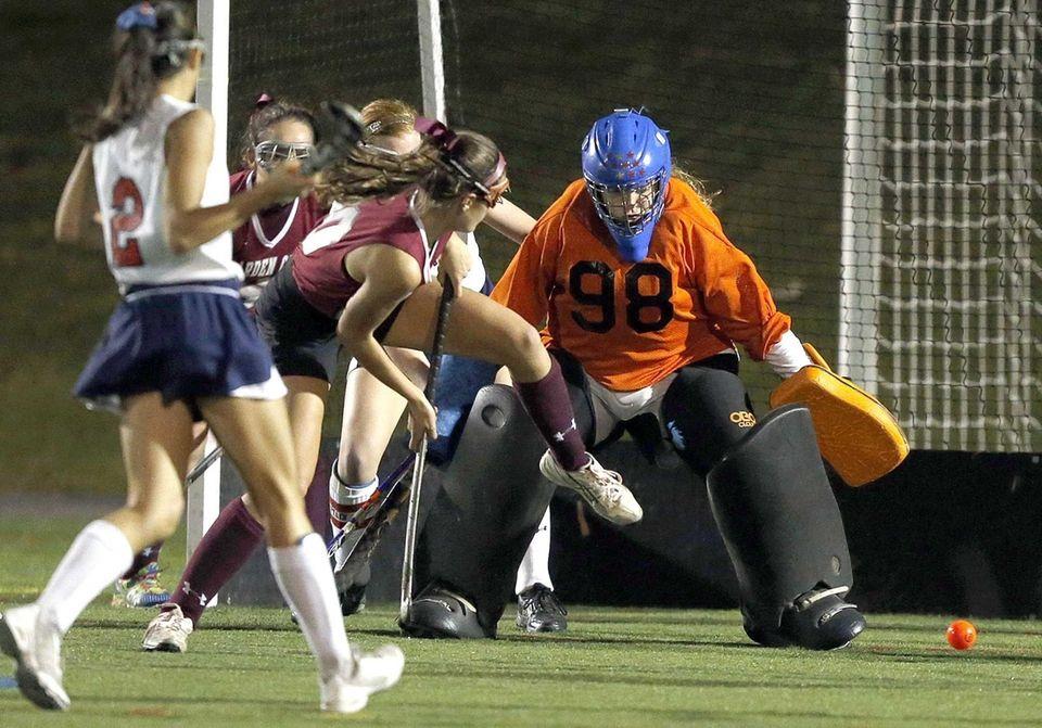 Garden City's Melanie McHugh's shot on goal sails