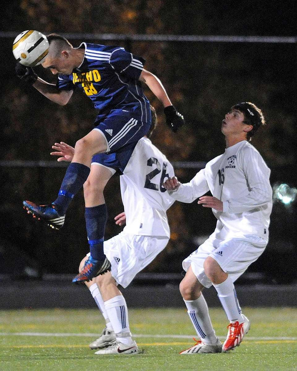 Jericho's David Greenbaum makes a header during the