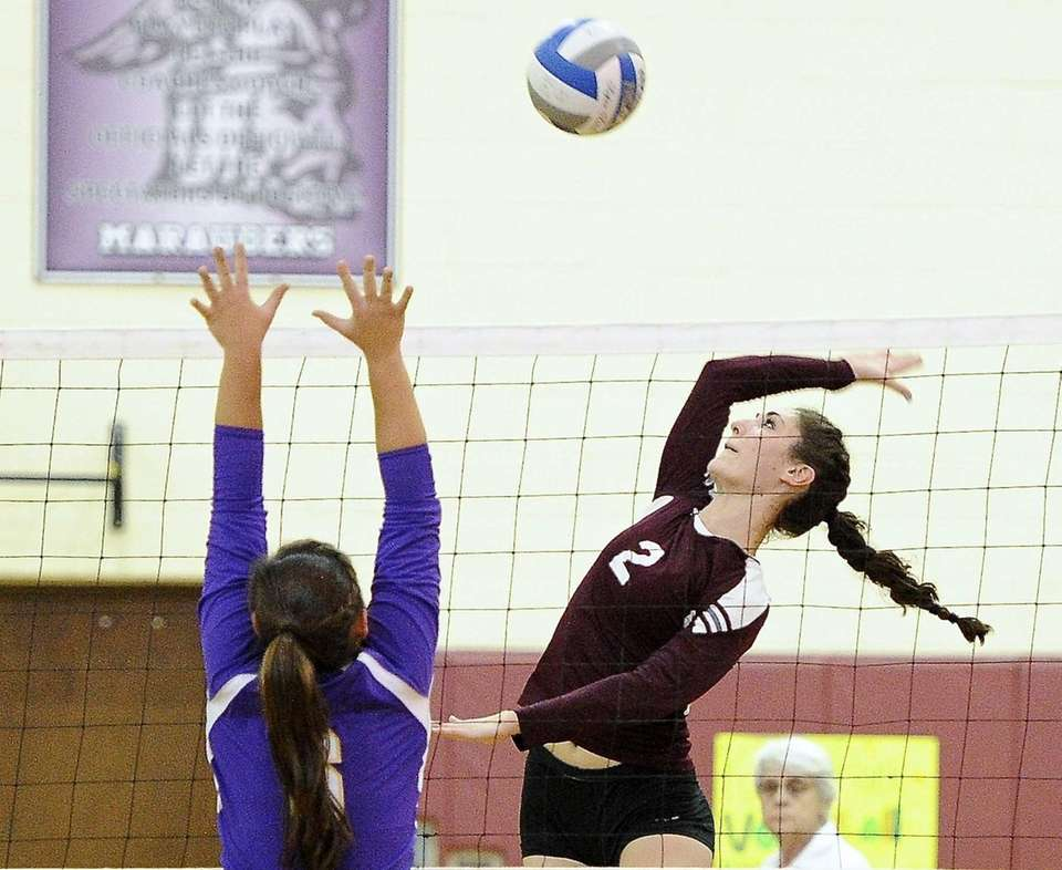 Kings Park's Joelle Goldstein returns the ball against