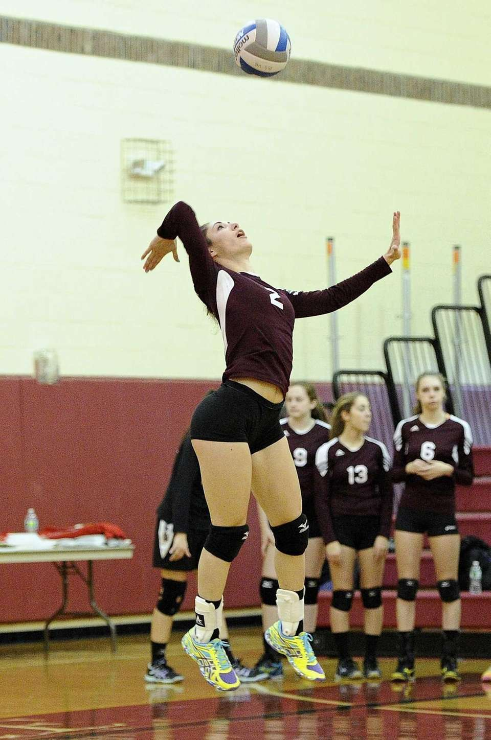 Kings Park's Joelle Goldstein serves the ball against