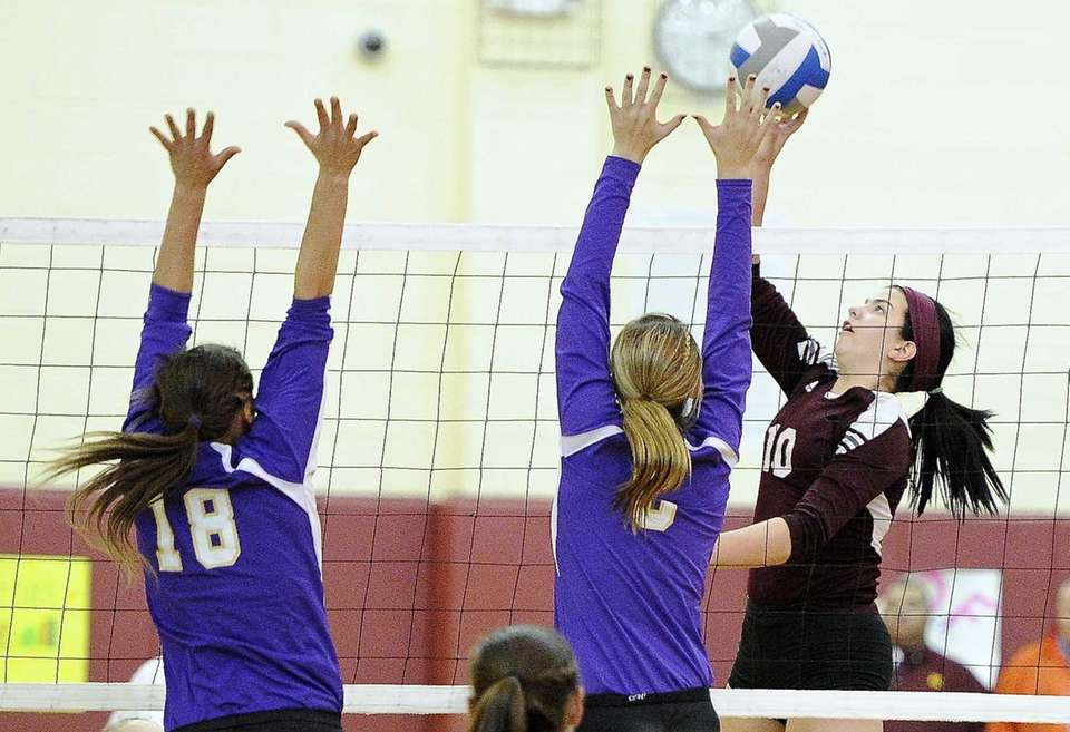 Kings Park's Amanda Gannon hits the ball against