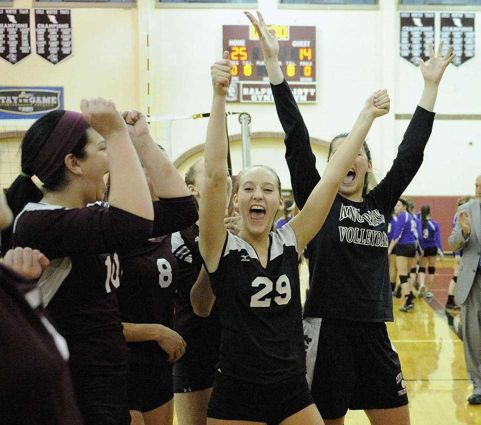Kings Park's Erin MacDougall and teammates celebrate their