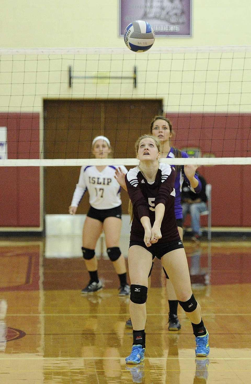 Kings Park's Kendall Corcoran digs the ball against