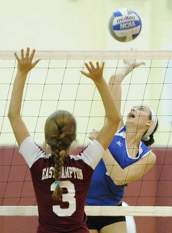John Glenn's Laurie Malloy hits the ball against