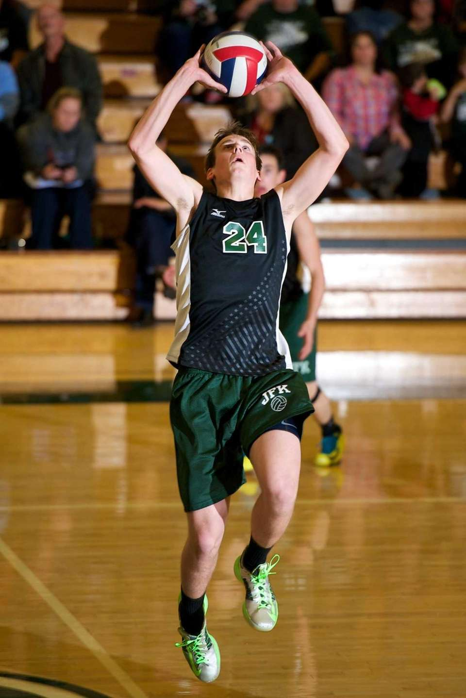 Bellmore JFK senior Gary Anderson (24) sets the