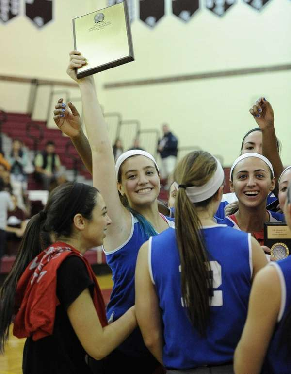John Glenn's captain Stephanie Viteritti raises the championship
