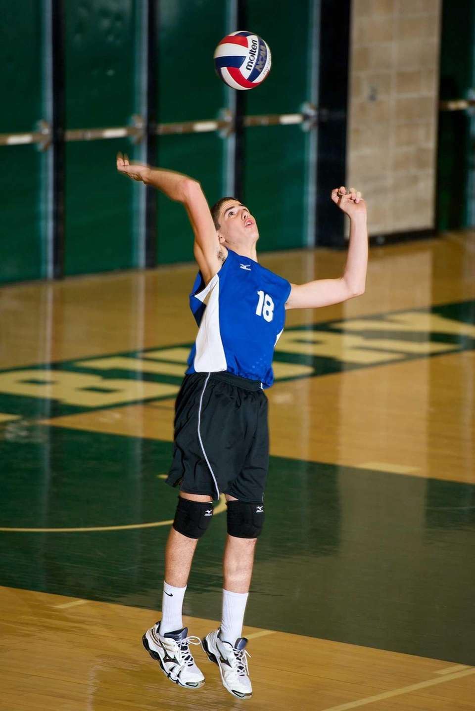 Long Beach's Ryan Silverman (18) serves the ball