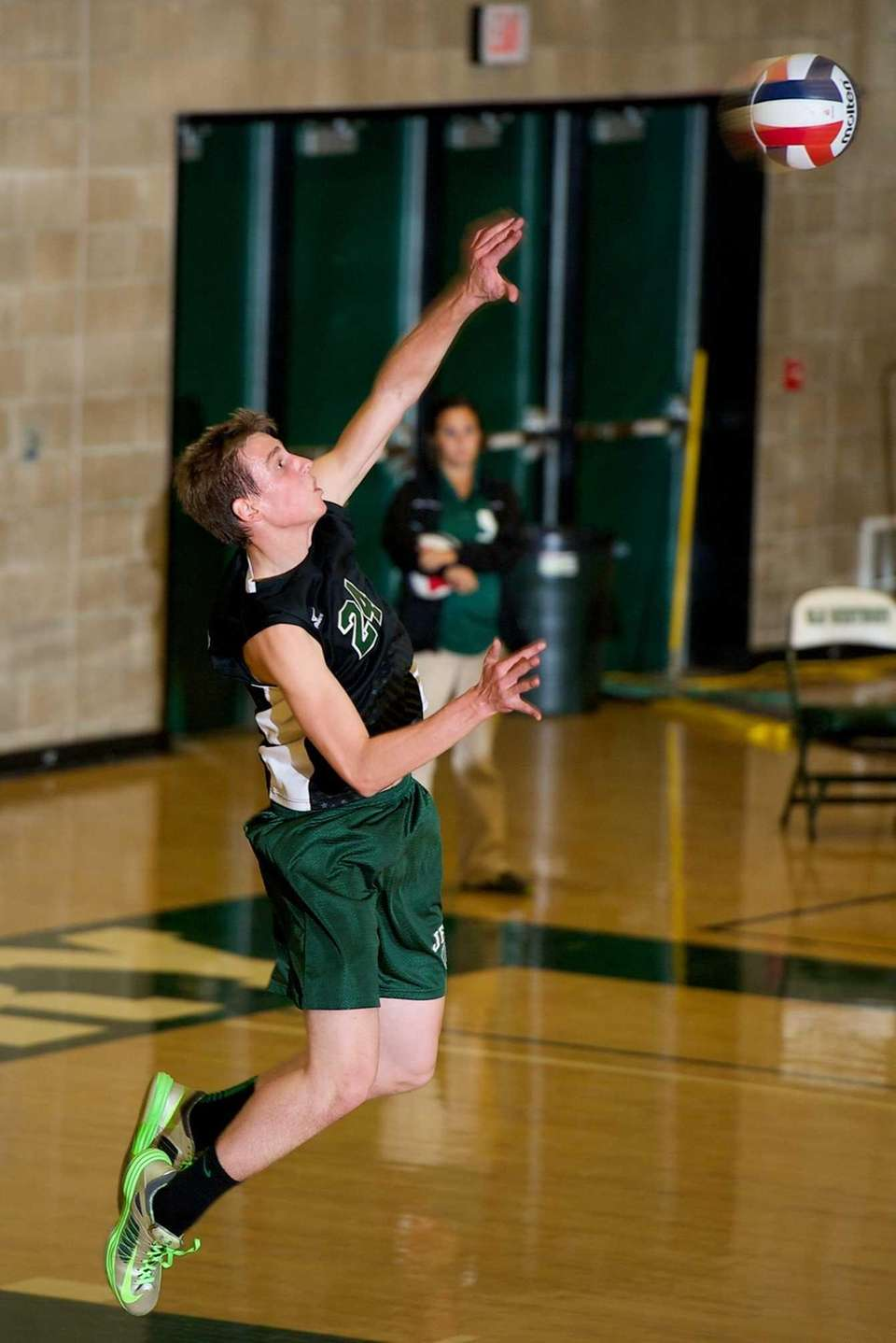 Bellmore JFK senior Gary Anderson (24) serves the