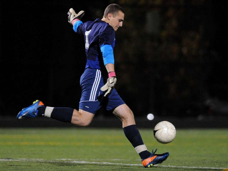 Massapequa goalie Daniel Vitiello kicks upfield during the