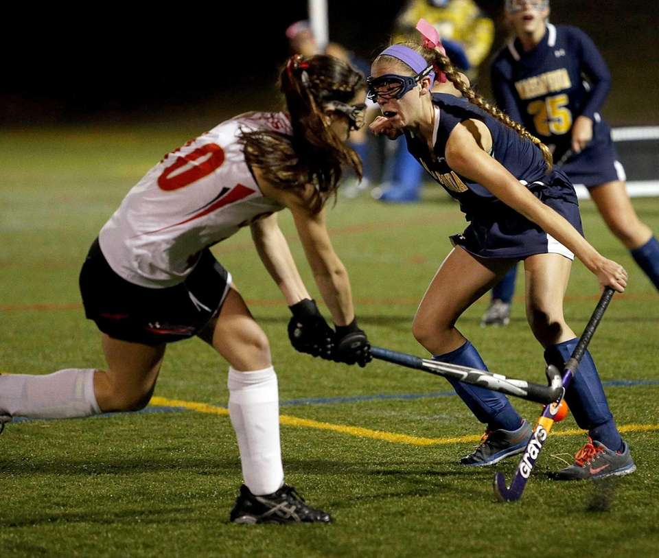 Massapequa's Kerri Sayrafe uses het stick to block