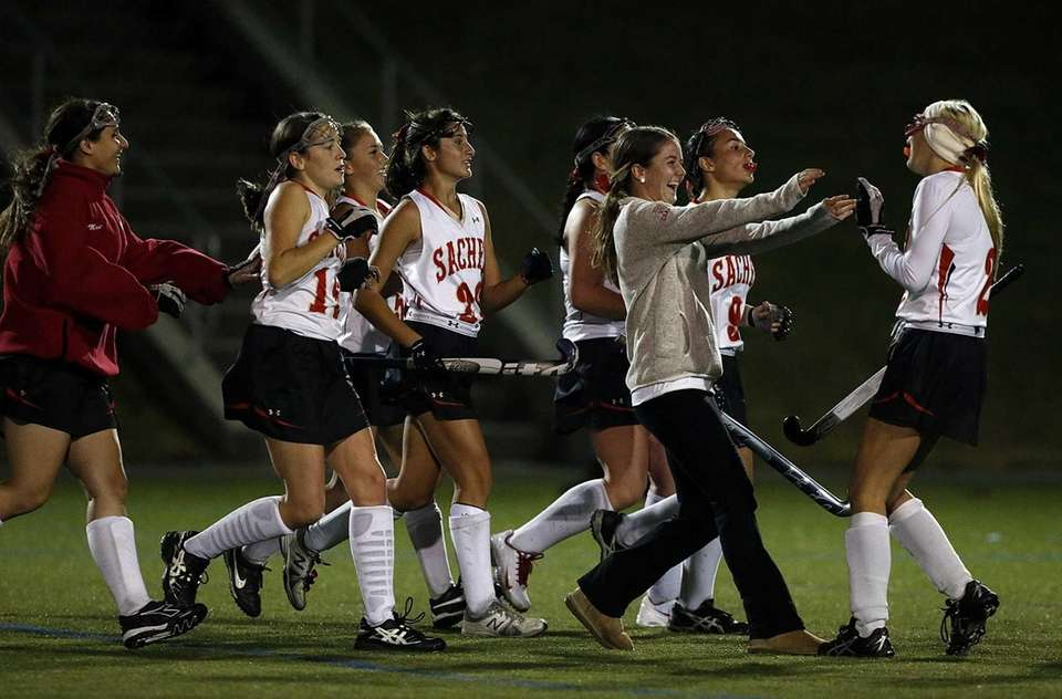 Sachem East players celebrate their victory after the