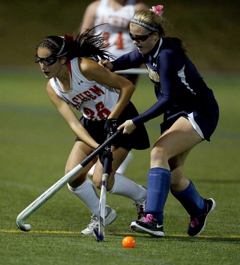 Sachem's Kaitlyn Shanahan passes the ball under the