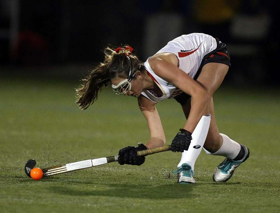 Sachem's Katie Trombetta bends low to sweep a